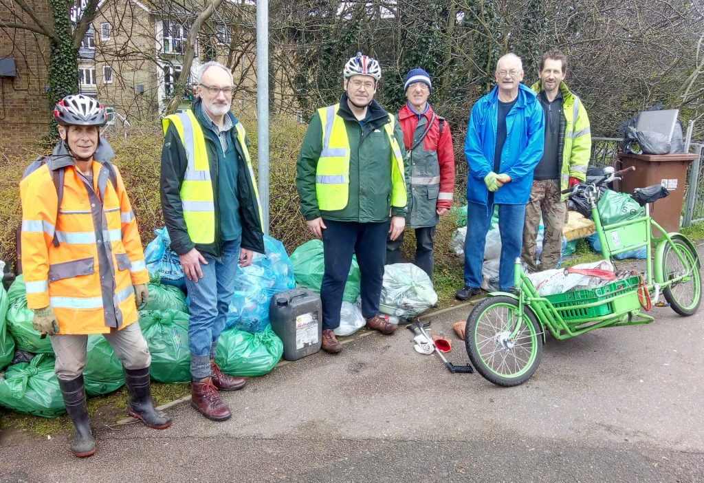 Team of volunteers in front of the 60 bags of litter cleared from the Alban Way in Hatfield.