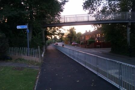 Cycle path alongside Wellfield road passing under the Alban Way bridge